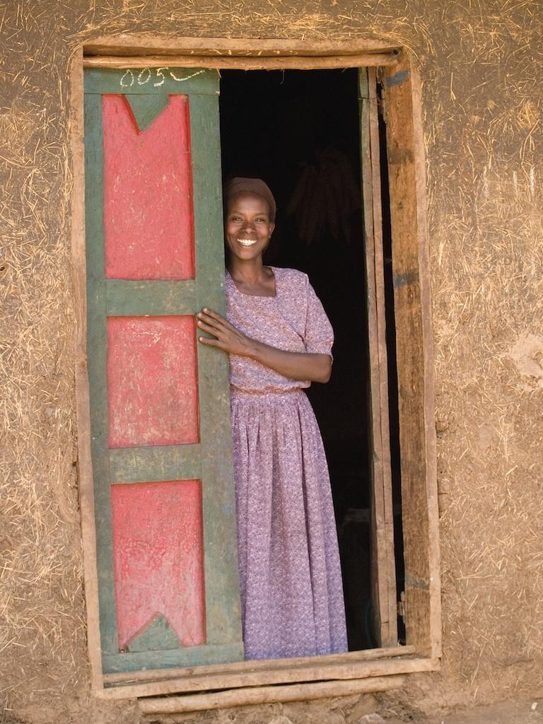 A lady standing in the doorway of her house in Ethiopia