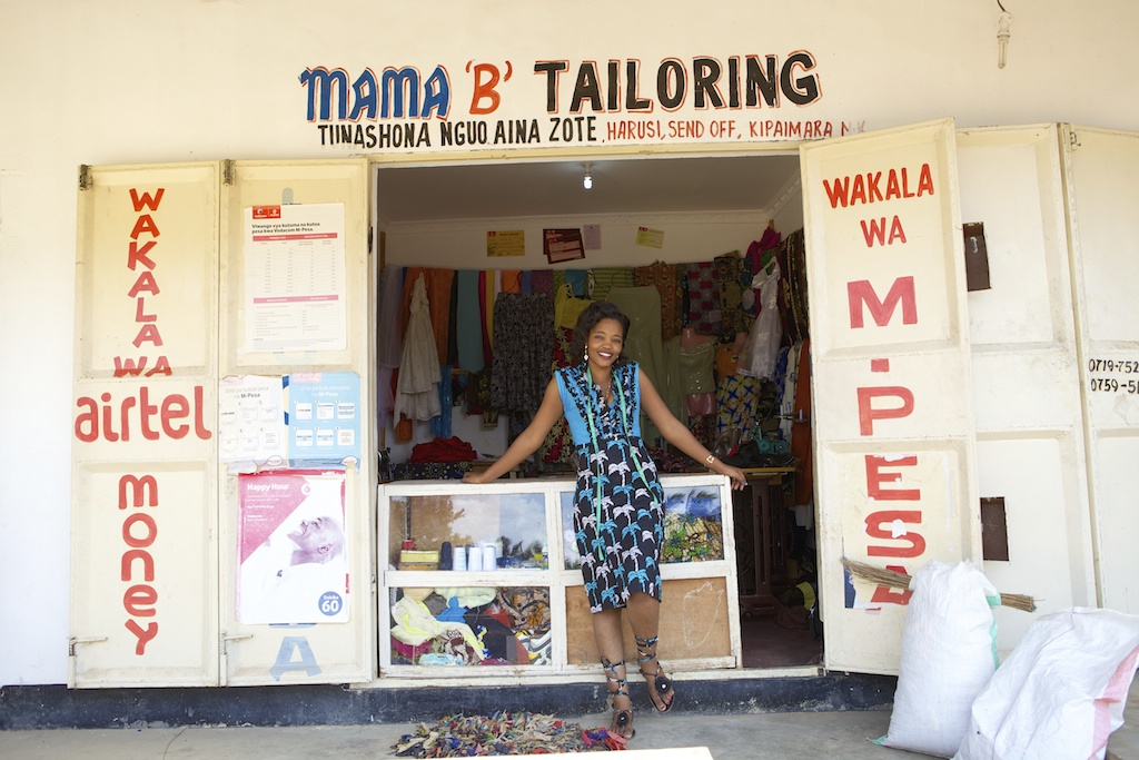 A tailor outside her shop in Tanzania