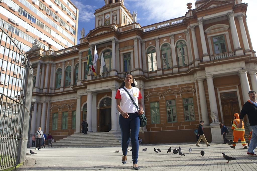 C&A Instituto volunteer walking away from City Hall in Porte Alegre, Brazil.