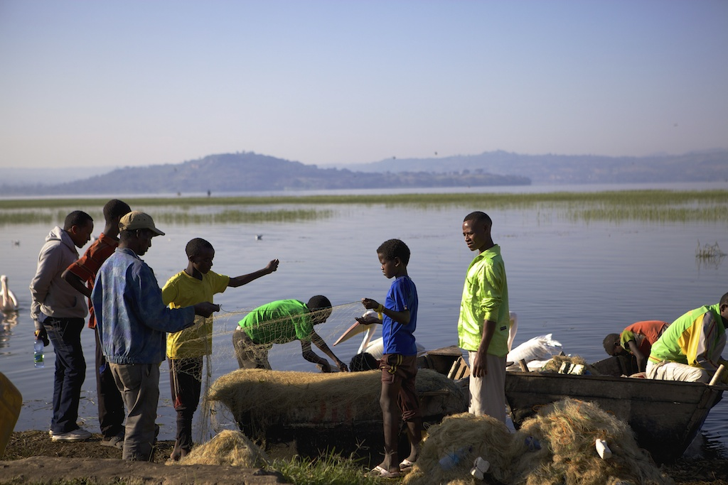 Children mending nets by the side of Lake Hawassa