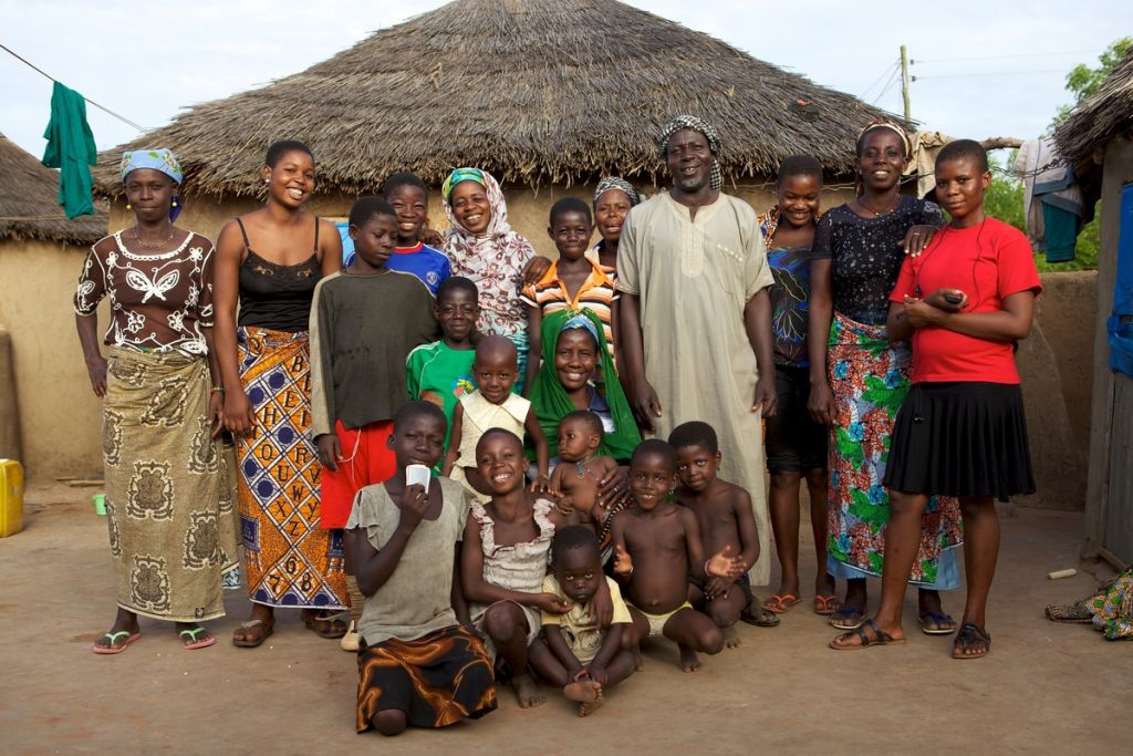 A large family photo outside their home in northern Ghana