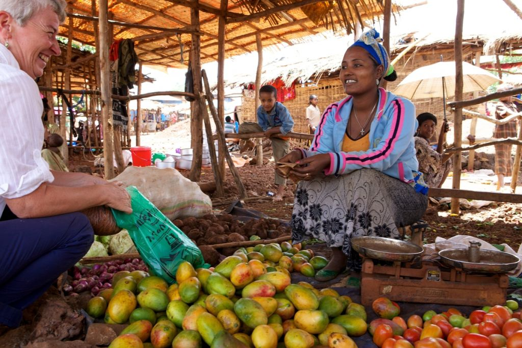 A british lady buying fruit in an Ethiopian market