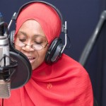 A teacher reads conducts a lesson over the radio in Zanzibar.