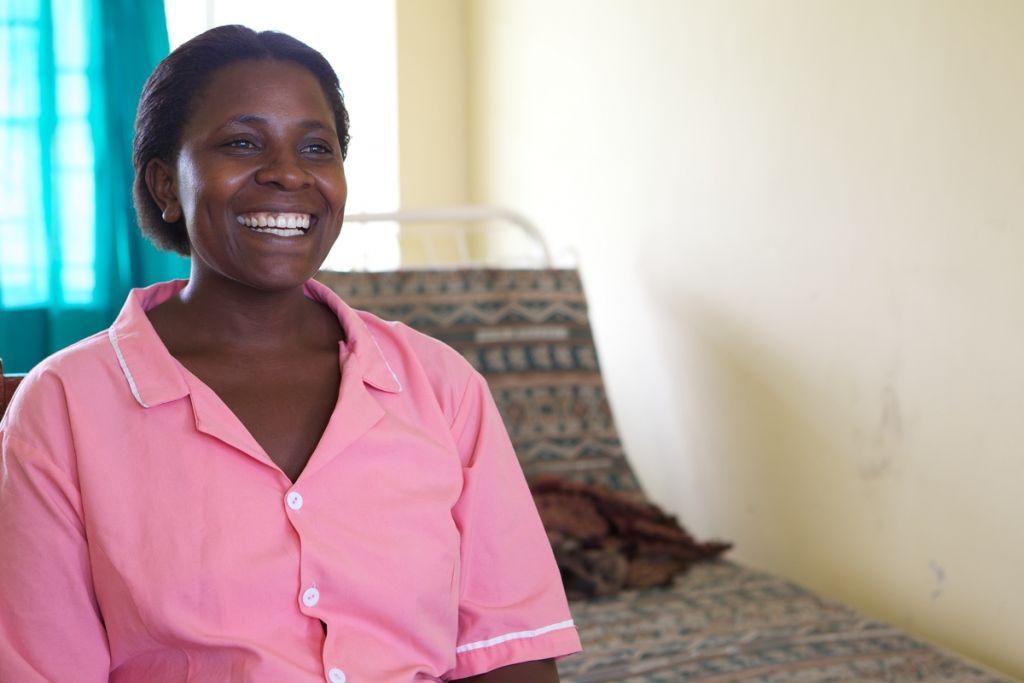 A midwife smiling, Uganda