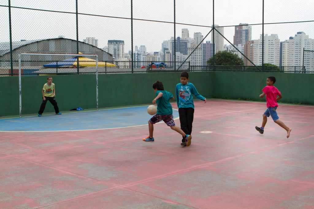 Boys playing football at school.