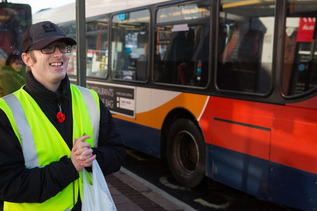 partially sighted man catching a bus