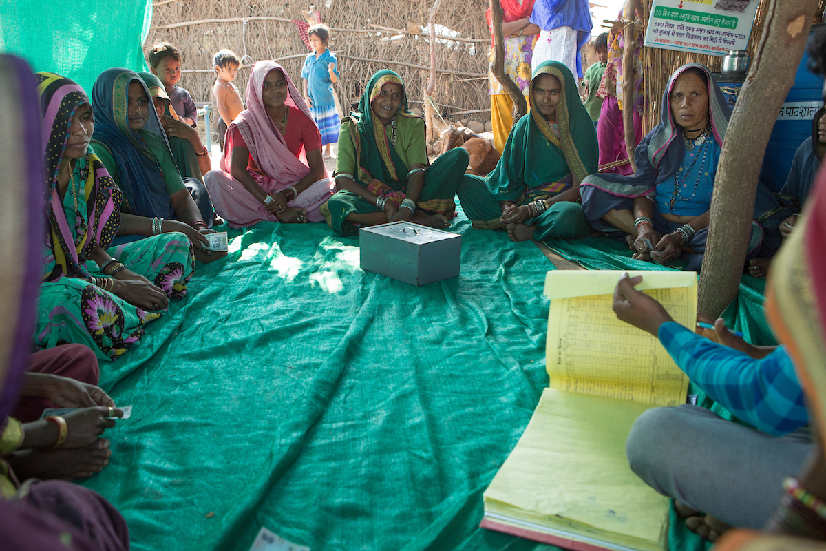 a group of female farmers in a meeting, India