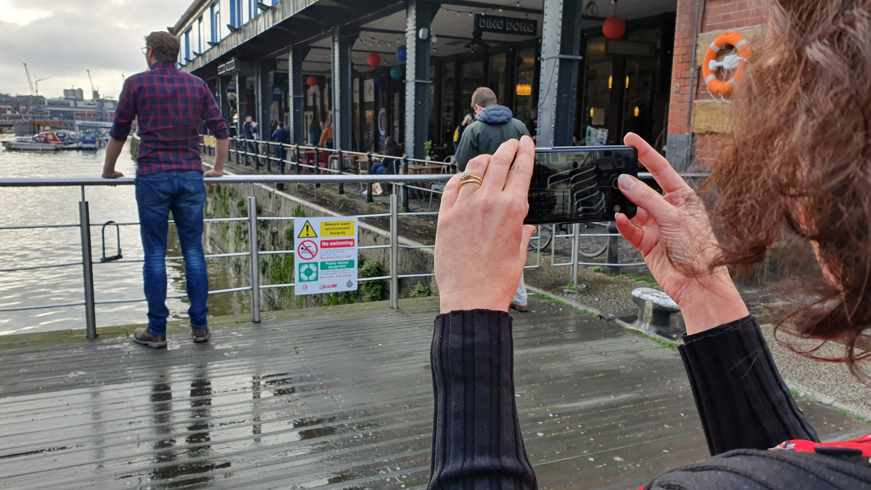 woman using a smartphone on a filmmaking course